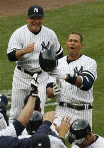 New York Yankees batter Alex Rodriguez reacts and throws up his batting helmet as he arrives at home plate after hitting a grand slam home run with two out in the ninth inning to beat the Baltimore Orioles in their American League baseball game at Yankee Stadium in New York in this April 7, 2007 file photo. REUTERS/Ray Stubblebine