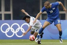 <p>Emil Martinez dell'Honduras e Lorenzo De Silvestri dell'Italia durante la partita di oggi REUTERS/Daniel Aguilar</p>