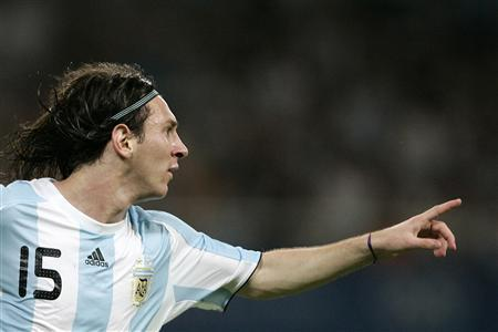Lionel Messi of Argentina celebrates after scoring a goal against Ivory Coast during their men's first round Group A soccer match at the Beijing 2008 Olympic Games in Shanghai Stadium August 7, 2008. REUTERS/Aly Song