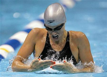 Amanda Beard swims in her heat of the Women's 200m Breaststroke at the U.S. Olympic Swimming Trials in Omaha, Nebraska, July 3, 2008. If 24-hour coverage of the Olympic Games in China isn't enough for fans, Sega has rolled out the official video game of the 2008 events in Beijing for PC, Xbox 360, PlayStation 3 and mobile phones. REUTERS/Jeff Haynes