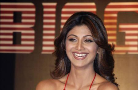 Bollywood actress Shilpa Shetty smiles during a news conference to announce the launch of ''Bigg Boss'' season 2 show on Colors television channel in Mumbai August 6, 2008. REUTERS/Manav Manglani