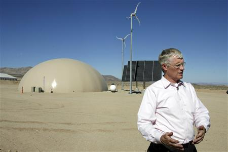 Alan Shaffer, acting director, Defense, Research and Engineering in the office of Acquistion, Logistics and Technology in the office of the Secretary of Defense is interviewed in front of a Net Zero Plus facility at the Army National Training Center in Fort Irwin, California July 31, 2008. REUTERS/Fred Prouser