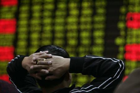 A man looks at an electronic screen at a brokerage house in Shanghai in this April 14, 2008 file photo. REUTERS/Aly Song/Files