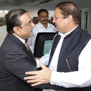 Asif Ali Zardari (L), widower of slain Benazir Bhutto and co-chairman of the ruling Pakistan People's Party, greets Pakistan's former Prime Minister Nawaz Sharif before a meeting in Islamabad August 7, 2008. REUTERS/Pakistan People's Party/Handout