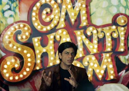 Shah Rukh Khan speaks during a news conference to launch the soundtrack of ''Om Shanti Om'' in Mumbai September 18, 2007. REUTERS/Punit Paranjpe/Files