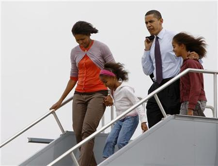 Democratic presidential candidate Senator Barack Obama and his wife Michelle step off their chartered plane with their daughters Malia (R) and Sasha (2nd L) at Indianapolis International Airport May 3, 2008. REUTERS/Jason Reed
