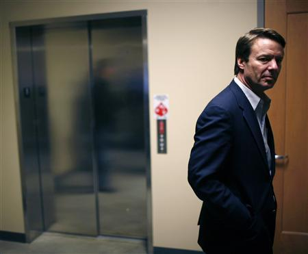 Former Democratic presidential candidate and former Senator John Edwards waits in a hallway while campaigning in Iowa City, January 2, 2008. REUTERS/John Gress