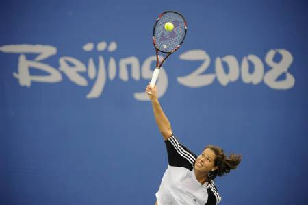 Ana Ivanovic of Serbia serves during a tennis  practice session ahead of the Beijing 2008 Olympic Games, August 6, 2008 REUTERS/Toby Melville