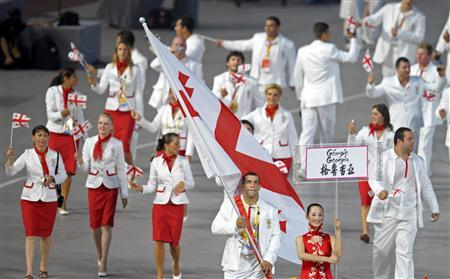 Georgia's Olympic team follow their national flag-bearer Ramaz Nozadze during the opening ceremony of the Beijing 2008 Olympic Games at the National Stadium, August 8, 2008. REUTERS/Adrees Latif