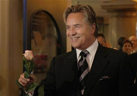 Don Johnson arrives with a rose for a musical premiere of ''Miami Nights'' in Munich November 7, 2007. REUTERS/Michaela Rehle