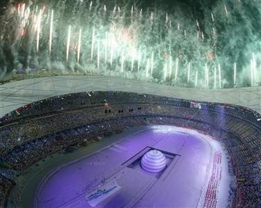 Fireworks illuminate the sky over the National Stadium during the opening ceremony of the Beijing 2008 Olympic Games, August 8, 2008. REUTERS/Lucy Nicholson