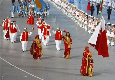 Bahrain's Olympic team follow their national flag-bearer Roqaya Al Ghasara during the opening ceremony of the Beijing 2008 Olympic Games at the National Stadium, August 8, 2008. REUTERS/Mike Blake