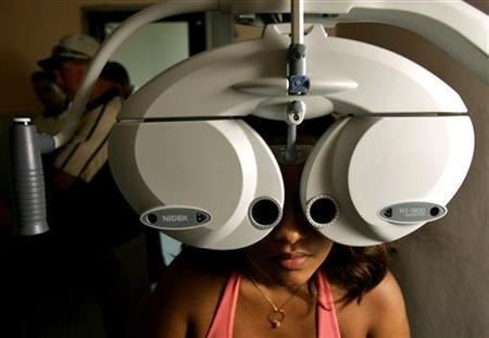 Patient Lisbet Luna Miopia receives a free eye exam from Cuban doctors at the Ramon Pando Ferrer hospital in Havana in this file photo from Sept. 12, 2006. REUTERS/Enrique De La Osa