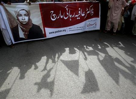 Pakistani Islamist party activists protest to show the solidarity with U.S.-trained neuroscientist Aafia Siddiqui during a demonstration in Karachi August 10, 2008. REUTERS/Athar Hussain