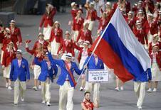 <p>Олимпийская команда России на открытии Олимпийских игр в Пекине 8 августа 2008 года. Олимпийские сборные России и Грузии решили не покидать игры в Пекине несмотря на военный конфликт, разгоревшийся в самопровозглашенной республике Южная Осетия, сообщил Международный олимпийский комитет. (REUTERS/Adrees Latif)</p>