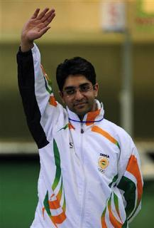 Abhinav Bindra of India waves during the medal ceremony of the men's 10m air rifle final shooting competition at the Beijing 2008 Olympic Games August 11, 2008. Ecstatic India lavished praise and nearly $400,000 in cash on Bindra after he won the first solo Olympic title for a medal-starved nation. REUTERS/Desmond Boylan