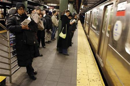 Commuters wait to board the New York City Subway in New York March 10, 2008. REUTERS/Keith Bedford