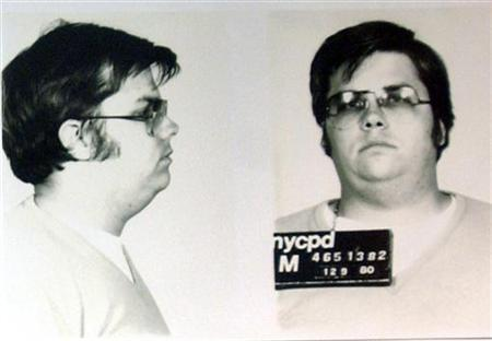 A mug-shot of Mark David Chapman, who shot and killed John Lennon, is displayed on the 25th anniversary of Lennon's death at the NYPD in New York December 8, 2005. REUTERS/Handout