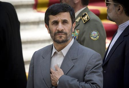Iranian President Mahmoud Ahmadinejad looks on as he waits for his Algerian counterpart Abdelaziz Bouteflika in Tehran August 11, 2008. REUTERS/Morteza Nikoubazl