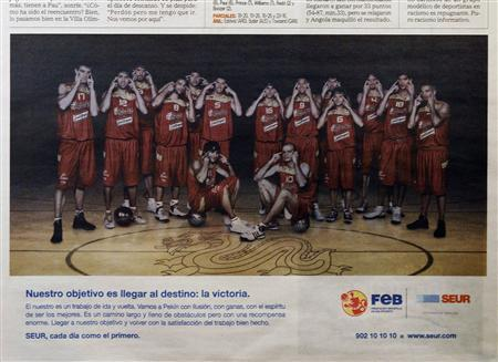The Spanish basketball team appears in an advertisement in the Spanish sports newspaper Marca August 13, 2008 showing the players making slit-eyed gestures. REUTERS/Susana Vera