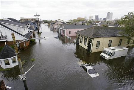 The Treme area of New Orleans lies under several feet of water after Hurricane Katrina hit in this file photo from August 29, 2005. In 2005 the U.S. Justice Department formed the Hurricane Katrina Fraud Task Force to combat fraud associated with billions of dollars in government aid allocated for victims of hurricanes Katrina, Rita and Wilma along the U.S. Gulf Coast. In a Sept 2007 report, the task force said it charged 188 people in Louisana with fraud or corruption since Sept 2005. To match feature NEWORLEANS/CORRUPTION REUTERS/Rick Wilking/files