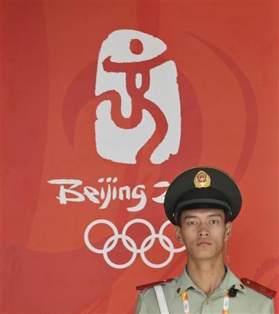 A paramilitary policeman stands guard at the entrance of the National Stadium, also known as the Bird's Nest, in Beijing, August 14, 2008. REUTERS/Joe Chan