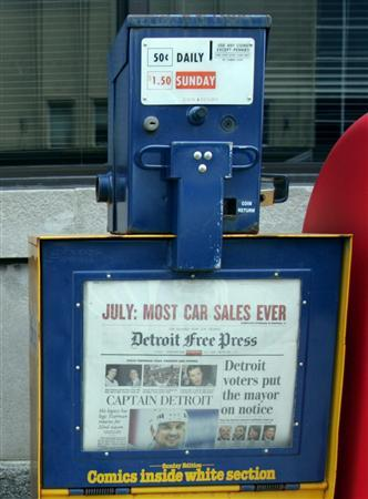 A Detroit Free Press newspaper box is seen in downtown Detroit, August 3, 2005. REUTERS/Rebecca Cook RC/TC