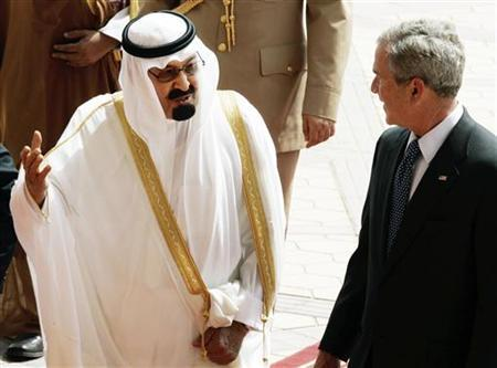 In this file photo U.S. President George W. Bush (R) meets with Saudi Arabian King Abdullah (L) outside the Royal Terminal at the Riyadh-King Khaled International Airport in Riyadh, May 16, 2008. The Kingdom of Saudi Arabia, four princes and other Saudi entities are immune from a lawsuit filed by victims of the September 11 attacks and their families alleging they gave material support to al Qaeda, a federal appeals court ruled on Thursday. REUTERS/Larry Downing