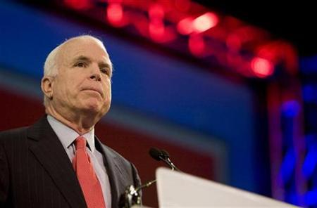 Republican presidential candidate Senator John McCain pauses for applause while speaking at the National Council of La Raza convention at San Diego's Convention Center July 14, 2008. REUTERS/Fred Greaves