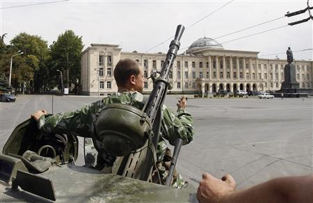 A Russian peacekeeper aboard his armoured personnel carrier moves in downtown Gori August 14, 2008. REUTERS/Denis Sinyakov