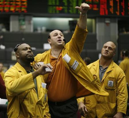 Clerks relay trades in the Euro Dollar pit at the Chicago Mercantile Exchange in a file photo. REUTERS/John Gress