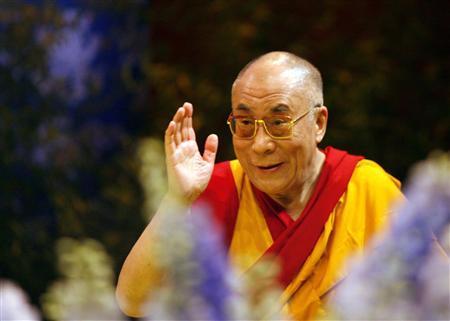 Tibetan spiritual leader Dalai Lama waves at the end of a teaching conference in Nantes, western France, August 16, 2008. The Dalai Lama is in France from August 11 to 23. REUTERS/Stephane Mahe