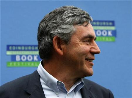 Prime Minister Gordon Brown smiles as he attends the opening day of The Edinburgh International Book Festival in Edinburgh, Scotland August 9, 2008. REUTERS/David Moir