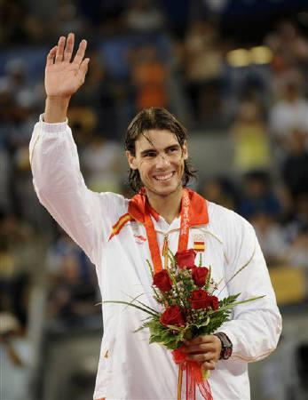 Gold medallist Rafael Nadal of Spain celebrates on the podium during the medal ceremony after the men's singles  tennis competition at the Beijing 2008 Olympic Games August 17, 2008. REUTERS/Toby Melville