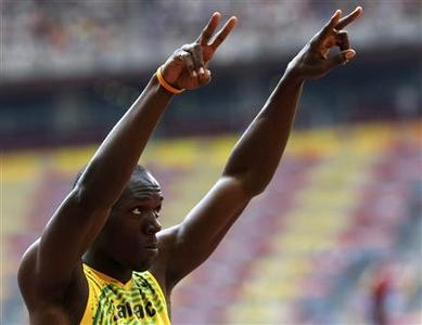 Usain Bolt of Jamaica gestures before his men's 200m heat of the athletics competition in the National Stadium at the Beijing 2008 Olympic Games August 18, 2008. REUTERS/Ruben Sprich