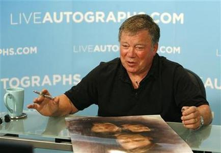 William Shatner gestures during an autograph session for LiveAutographs.com in Culver City, California August 13, 2008. REUTERS/Mario Anzuoni