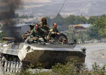 Russian soldiers travel on top of an armoured vehicles on a road near the Georgian town of Gori August 18, 2008. REUTERS/Gleb Garanich