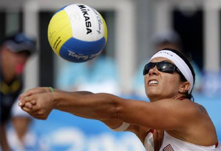 Misty May-Treanor of the U.S. hits the ball during their women's round of 16 beach volleyball match against Belgium at the Beijing 2008 Olympic Games August 15, 2008. REUTERS/Carlos Barria