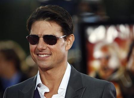 Cast member Tom Cruise poses at the premiere of ''Tropic Thunder'' at the Mann's Village theatre in Westwood, California August 11, 2008. The movie opens in the U.S. on August 13. REUTERS/Mario Anzuoni