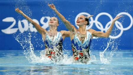 Anastasia Davydova and Anastasia Ermakova of Russia perform in the synchronised swimming duet free routine preliminary round at the Beijing 2008 Olympic Games August 19, 2008. REUTERS/Aly Song