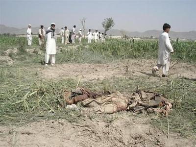 Bodies of suicide bombers are seen after they detonated themselves in Khost province, eastern Afghanistan, August 19, 2008. REUTERS/Stringer