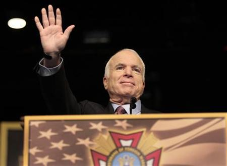 U.S. Republican presidential candidate Senator John McCain (R-AZ) waves to the veterans gathered at the 109th Veterans of Foreign Wars convention in Orlando, Florida, August 18, 2008. REUTERS/Scott Audette