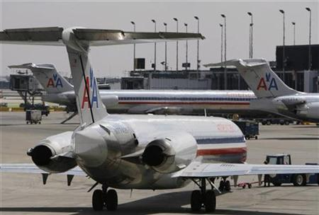American Airlines MD-80 aircrafts sit on the tarmac at Chicago's O'Hare International Airport April 9, 2008. REUTERS/John Gress