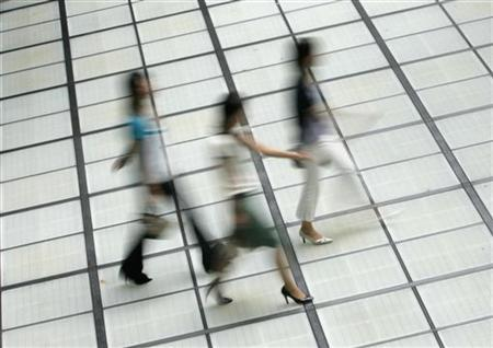 Women walk through a street in Tokyo August 13, 2008. REUTERS/Yuriko Nakao