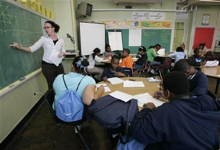 Teacher Darcy McKinnon teaches math to her seventh grade class at Samuel J. Green Charter School in New Orleans February 22, 2006. REUTERS/Lee Celano