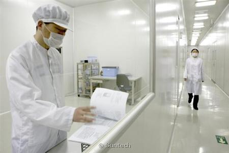 Suntech employees work at the company's R&D facility in an undated handout photo. REUTERS/Suntech/Handout