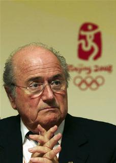FIFA's President Sepp Blatter pauses during a news conference in Beijing August 21, 2008. Blatter said he did not want any changes to the controversial format for Olympic Games soccer and promised there would be no repeat of the confusion over the participation of Argentina's Lionel Messi. REUTERS/Grace Liang