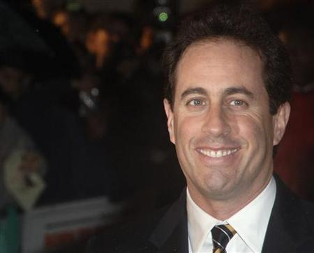 Jerry Seinfeld poses at the premiere of ''Bee Movie'' in London December 6, 2007. REUTERS/Anthony Harvey