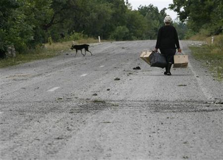 A Georgian woman leaves her village near the town of Tskhinvali, some 100km (62 miles) from Tbilisi, August 10, 2008. REUTERS/David Mdzinarishvili