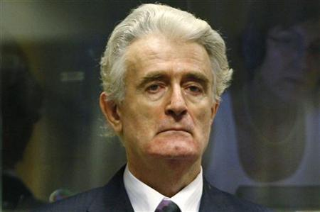Former Bosnian Serb leader Radovan Karadzic stands in the court room of the International Criminal Tribunal for the Former Yugoslavia at the start of his initial appearance in The Hague July 31, 2008. REUTERS/Jerry Lampen